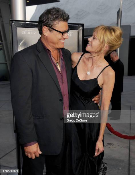 Actors Melanie Griffith and Steven Bauer arrive at the Los Angeles premiere of Dark Tourist at ArcLight Hollywood on August 14 2013 in Hollywood...