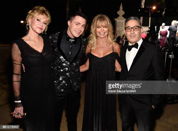 actors Melanie Griffith Colton Haynes Goldie Hawn and film producer Jason Weinberg attend the amfAR Gala Los Angeles 2017 at Ron Burkle's Green Acres...