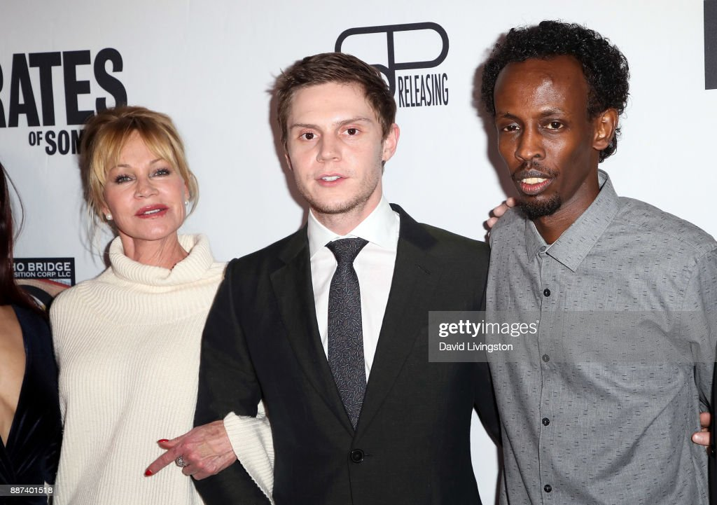Actors Melanie Griffith, Evan Peters and Barkhad Abdi attend the premiere of Front Row Filmed Entertainment's 'The Pirates of Somalia' at TCL Chinese 6 Theatres on December 6, 2017 in Hollywood, California.
