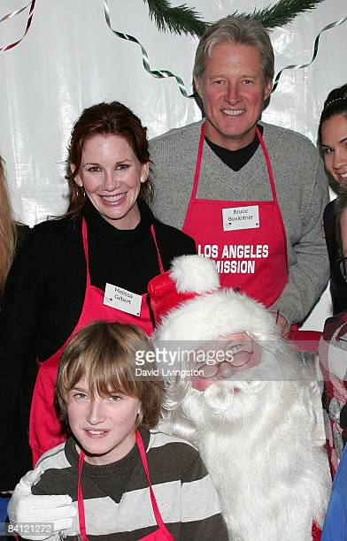 Actors Melissa Gilbert and Bruce Boxleitner pose with their son Michael Boxleitner and Santa during Christmas Eve at the Los Angeles Mission on...