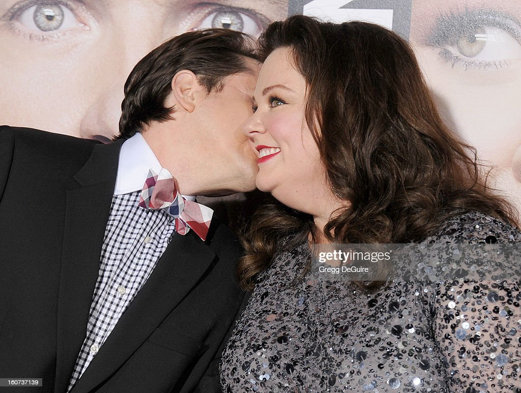 Actors Melissa McCarthy (R) and husband Ben Falcone arrive at the 'Identity Thief' Los Angeles premiere at Mann Village Theatre on February 4, 2013 in Westwood, California.