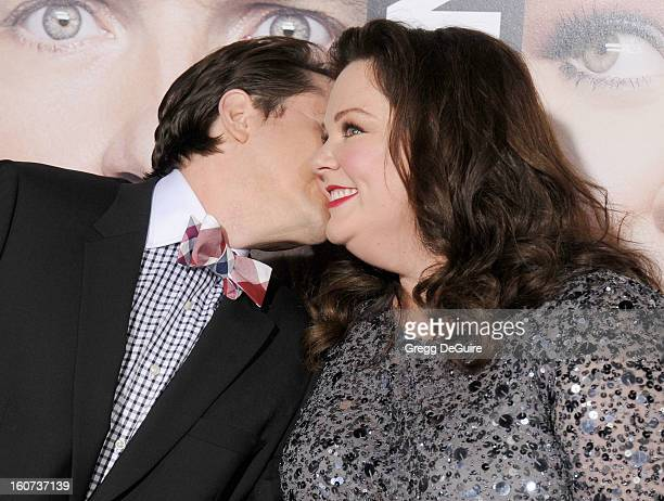 """Actors Melissa McCarthy and husband Ben Falcone arrive at the """"Identity Thief"""" Los Angeles premiere at Mann Village Theatre on February 4, 2013 in..."""