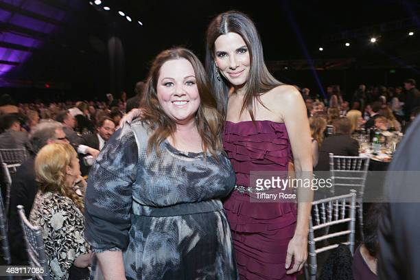 Actors Melissa McCarthy and Sandra Bullock with Champagne Nicolas Feuillatte at the 19th Annual Critics' Choice Movie Awards at Barker Hangar on...