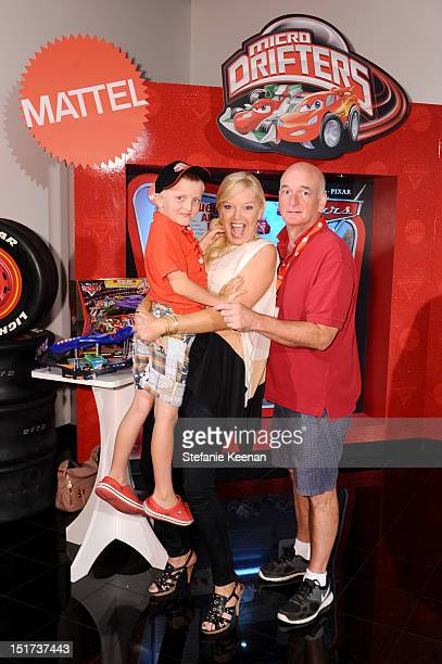 Actors Melissa Peterman and John Brady with son Riley attend Mattel's Micro Drifters Toy Test Drive at the Petersen Automotive Museum on September 10...