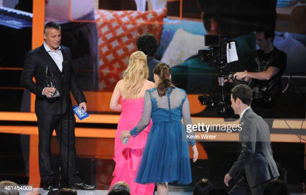 Actors Melissa Rauch Mayim Bialik and Jim Parsons walk onstage to accept the Favorite Network TV Comedy award for 'The Big Bang Theory' from actor...