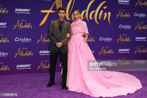 """Actors Mena Massoud and Naomi Scott attend the premiere of Disney's """"Aladdin"""" on May 21, 2019 in Los Angeles, California."""