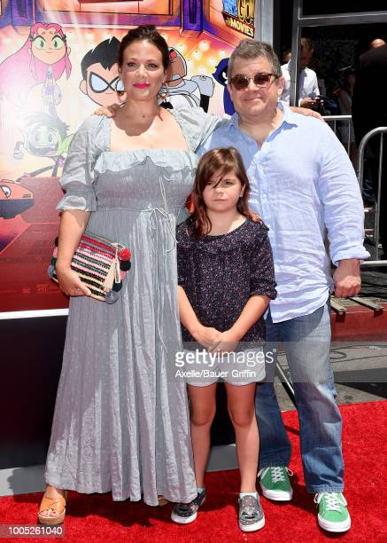 Actors Meredith Salenger Patton Oswalt and daughter Alice Rigney Oswalt arrive at the Los Angeles premiere of Warner Bros Animations' 'Teen Titans Go...