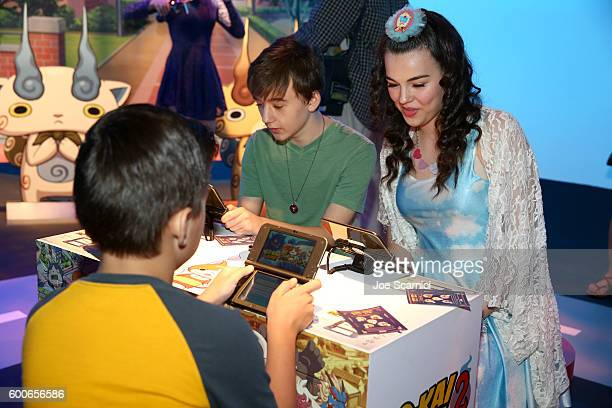 Actors Merit Leighton and Benjamin Stockham check out YoKai Watch 2 for Ninendo 3DS at the YOKAI WATCH 2 preview event at Siren Studios on September...