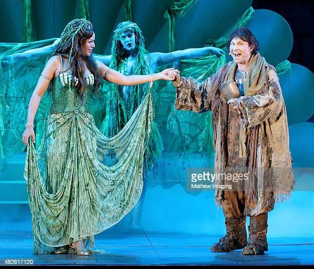 Actors Merle Dandridge and Christian Slater perform onstage during Monty Python Spamalot at the Hollywood Bowl on July 31 2015 in Hollywood California