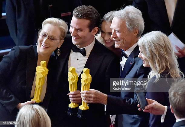 Actors Meryl Streep and Bradley Cooper and actor/director Clint Eastwood pose onstage during the 87th Annual Academy Awards at Dolby Theatre on...