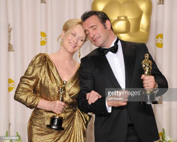 Actors Meryl Streep and Jean Dujardin pose in the press room at the 84th Annual Academy Awards held at the Hollywood Highland Center on February 26...