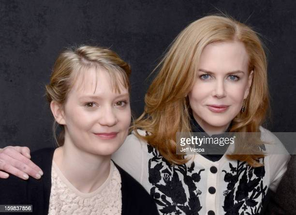 Actors Mia Wasikowska and Nicole Kidman pose for a portrait during the 2013 Sundance Film Festival at the WireImage Portrait Studio at Village At The...
