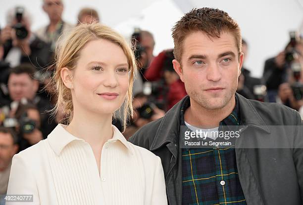 Actors Mia Wasikowska and Robert Pattinson attend the 'Maps To The Stars' photocall during the 67th Annual Cannes Film Festival on May 19 2014 in...