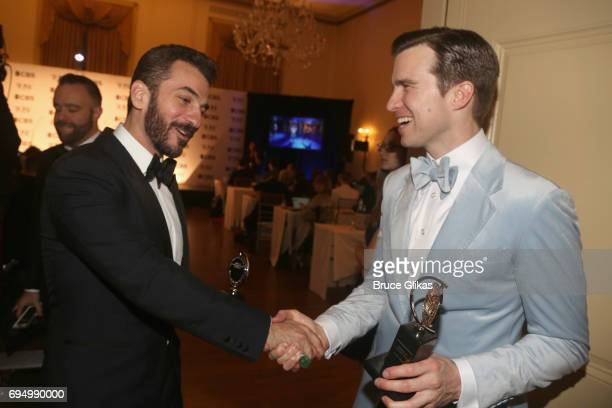 Actors Michael Aronov and Gavin Creel celebrate in the press room during the 71st Annual Tony Awards at 3 West Club on June 11, 2017 in New York City.