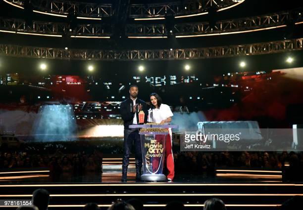 Actors Michael B. Jordan and Mila Kunis speak onstage at the 2018 MTV Movie And TV Awards at Barker Hangar on June 16, 2018 in Santa Monica,...