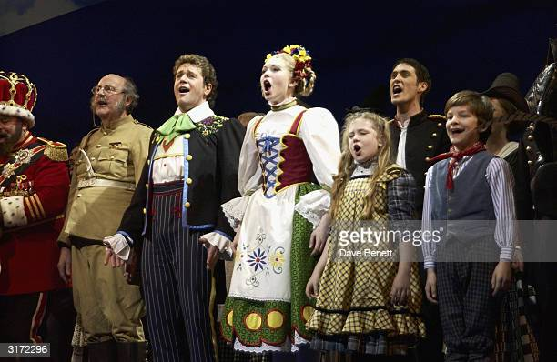 Actors Michael Ball and Emma Williams on stage with cast during the opening night of the musical 'Chitty Chitty Bang Bang' at the London Palladium on...