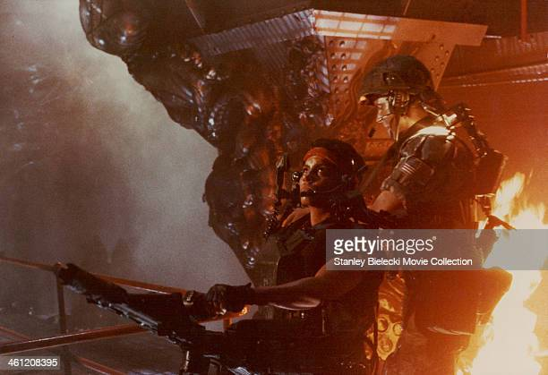 Actors Michael Biehn and Jenette Goldstein in a battle scene from the movie 'Aliens' 1986