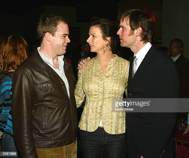 Actors Michael C Hall Rachel Griffiths and Peter Krause talk at the afterparty for the premiere of HBO's Six Feet Under at The Highlands on February...