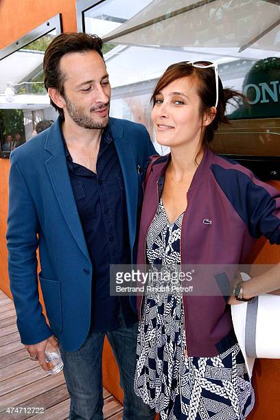 Actors Michael Cohen and Julie de Bona attend the 2015 Roland Garros French Tennis Open Day 2 on May 25 2015 in Paris France