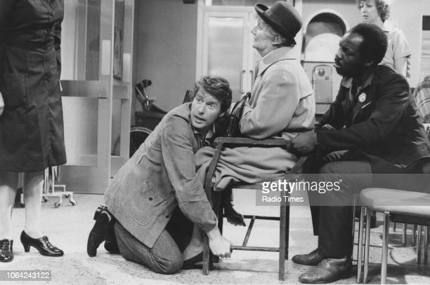 Actors Michael Crawford Hazel Bainbridge and Carl Andrews in a scene from episode 'Wendy House' of the television sitcom 'Some Mothers Do 'Ave 'Em'...