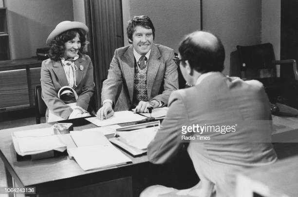 Actors Michael Crawford Michele Dotrice and Edward Hardwicke in a scene from episode 'Australia House' of the television sitcom 'Some Mothers Do 'Ave...