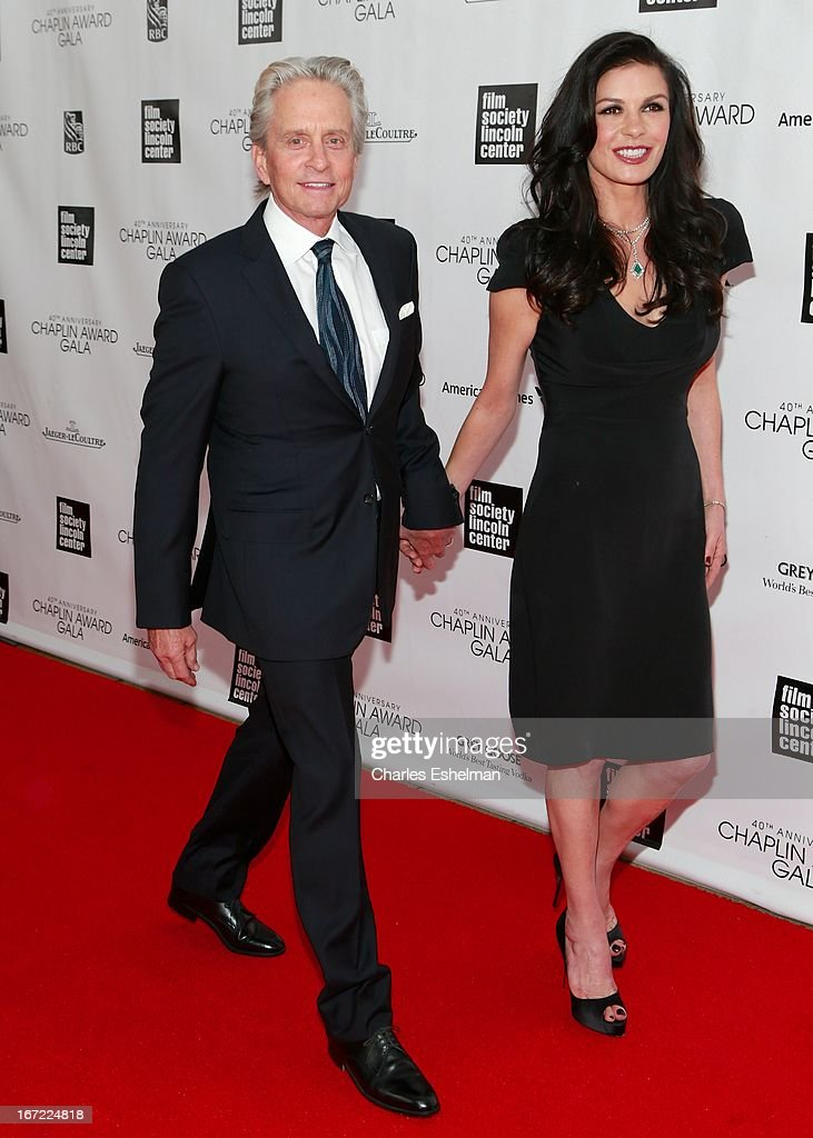 Actors Michael Douglas and Catherine Zeta Jones arrive at the 40th Anniversary Chaplin Award Gala at Avery Fisher Hall at Lincoln Center for the Performing Arts on April 22, 2013 in New York City.