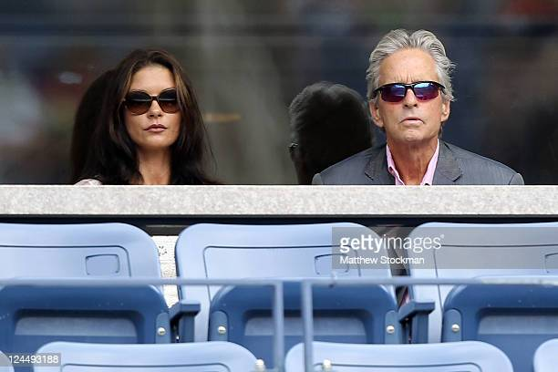 Actors Michael Douglas and Catherine ZetaJones attend Day Thirteen of the 2011 US Open at the USTA Billie Jean King National Tennis Center on...