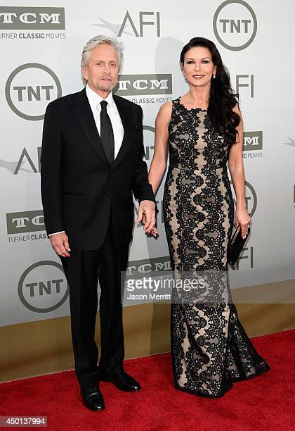 Actors Michael Douglas and Catherine ZetaJones attend the 2014 AFI Life Achievement Award A Tribute to Jane Fonda at the Dolby Theatre on June 5 2014...