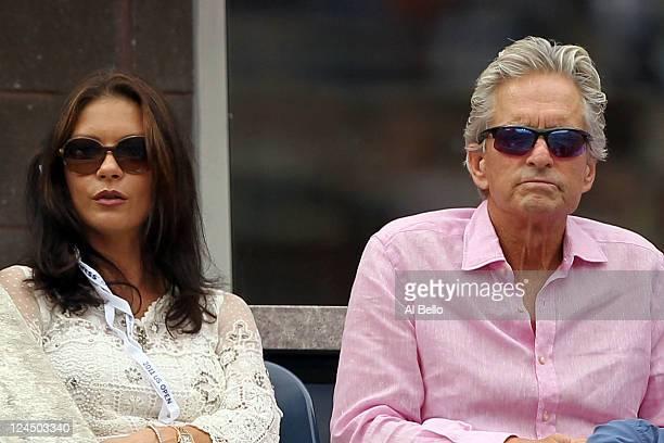 Actors Michael Douglas and Catherine ZetaJones attend the match between Roger Federer of Switzerland and Novak Djokovic of Serbia on Day Thirteen of...