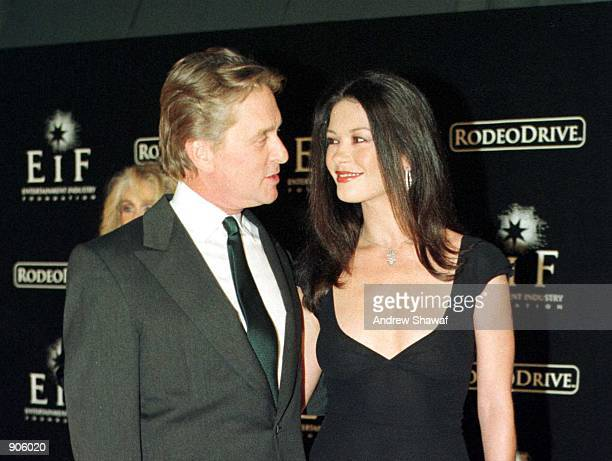 Actors Michael Douglas and Catherine ZetaJones attend the 'Tribute To Style' exhibition and concert November 7 1999 in Beverly Hills Ca On August 8...