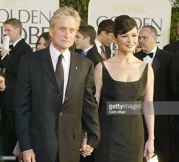 Actors Michael Douglas and wife Catherine ZetaJones attend the 61st Annual Golden Globe Awards at the Beverly Hilton Hotel on January 25 2004 in...
