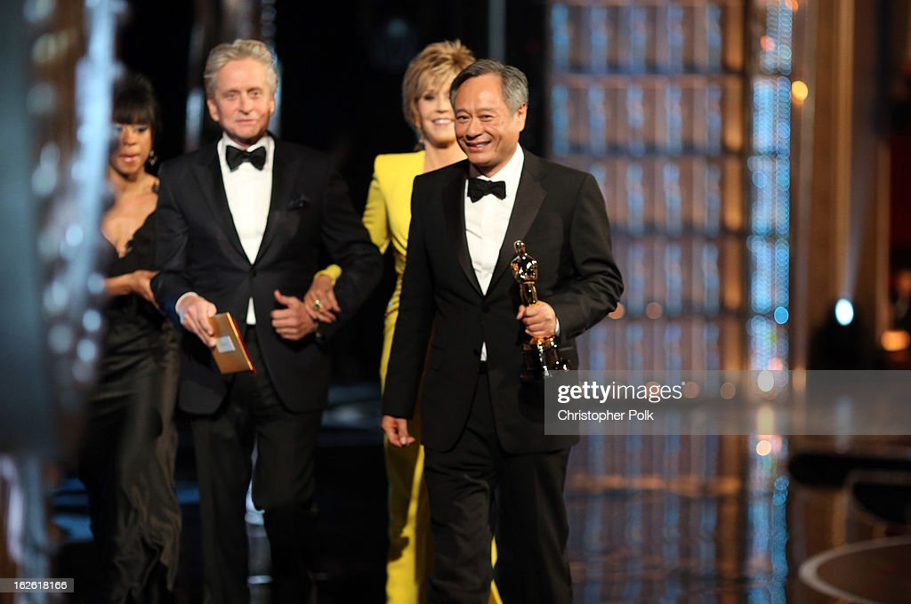 Actors Michael Douglas,Jane Fonda, and Director Ang Lee accepts Academy Award for Best Director seen from backstage during the Oscars held at the Dolby Theatre on February 24, 2013 in Hollywood, California.