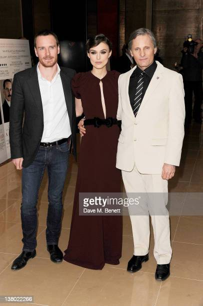 Actors Michael Fassbender Keira Knightley and Viggo Mortensen attend the UK Gala Premiere of 'A Dangerous Method' at The Mayfair Hotel on January 31...