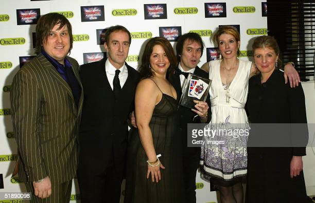 Actors Michael Fenton Stevens Angus Deayton Ruth Jones Kevin Eldon Julia Davis and Rebecca Front poses in the Awards Room with the award for...
