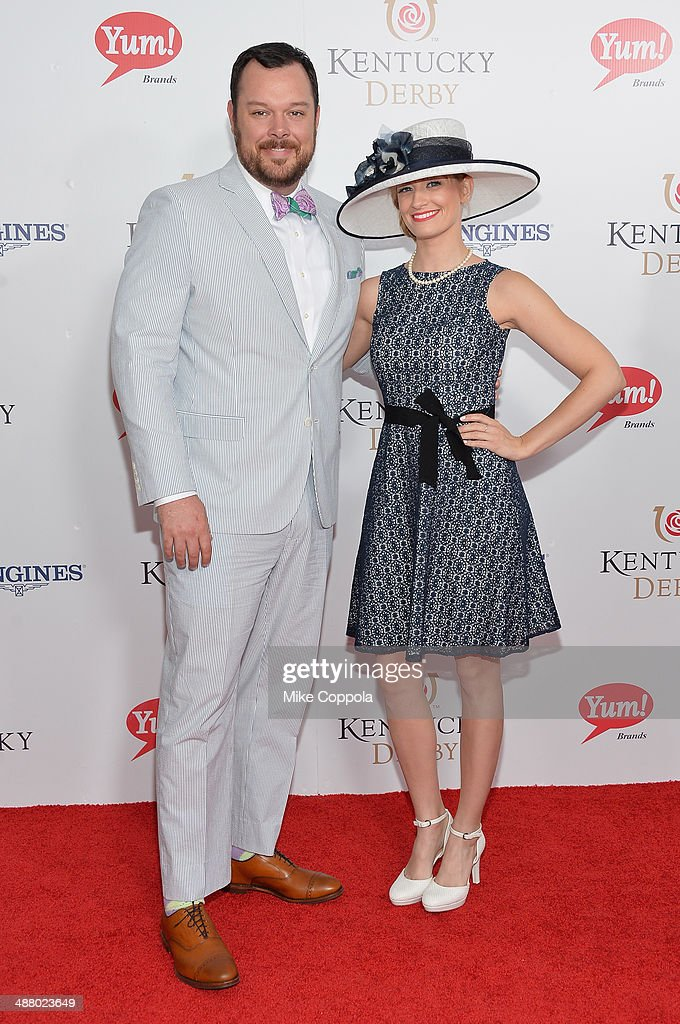 Actors Michael Gladis (L) and Beth Behrs attend 140th Kentucky Derby at Churchill Downs on May 3, 2014 in Louisville, Kentucky.