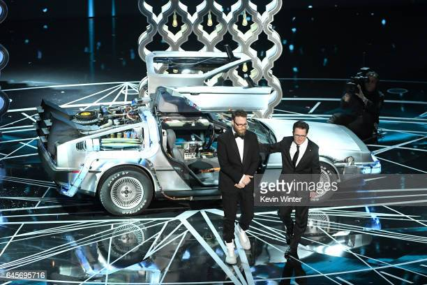 Actors Michael J Fox and Seth Rogen speak onstage during the 89th Annual Academy Awards at Hollywood Highland Center on February 26 2017 in Hollywood...