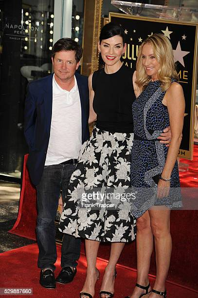 Actors Michael J Fox Julianna Maugulies and Tracy Pollan pose at the ceremony that honored her with a Star on the Hollywood Walk of Fame