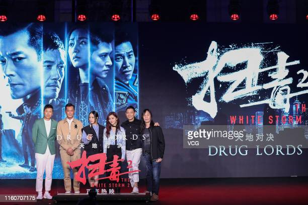 Actors Michael Miu, Louis Koo, Karena Lam, Michelle Wai, Andy Lau and director Herman Yau attend 'The White Storm 2: Drug Lords' press conference on...
