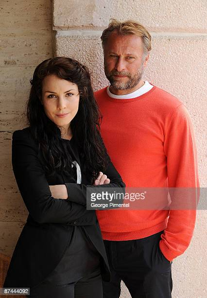Actors Michael Nyqvist and Noomi Rapace pose during the 'The Girl With the Dragon Tattoo' photo call at the Scandinavian Terrace during the 62nd...