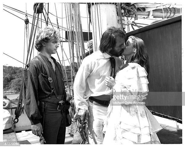 Actors Michael O'Keefe and Tommy Lee Jones with actress Jenny Seagrove on set of the Paramount Pictures movie Savage Islands in 1983