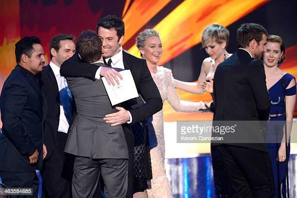 Actors Michael Pena Alessandro Nivola Jeremy Renner presenter Ben Affleck actors Elisabeth Rohm Jennifer Lawrence Bradley Cooper and Amy Adams accept...