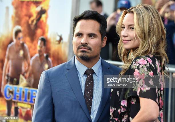 Actors Michael Pena and Brie Shaffer arrive at the Premiere Of Warner Bros Pictures' CHiPS at TCL Chinese Theatre on March 20 2017 in Hollywood...