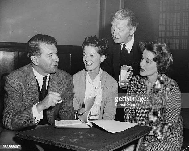 Actors Michael Redgrave Rachel Kempson Roger Livesey and Constance Cummings looking over a script together as they prepare to appear in the ITV...