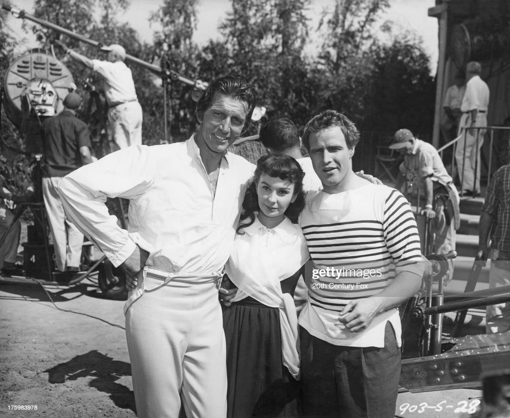 Actors (left to right) Michael Rennie (1909 - 1971), Jean Simmons (1929 - 2010) and Marlon Brando (1924 - 2004) on the set of 'Desiree', directed by Henry Koster, USA, 1954. They play the roles of Jean-Baptiste Bernadotte, Desiree Clary and Napoleon Bonaparte, respectively.