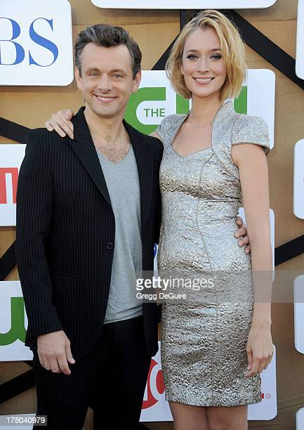Actors Michael Sheen and Caitlin FitzGerald arrive at the CBS/CW/Showtime Television Critic Association's summer press tour party at 9900 Wilshire...