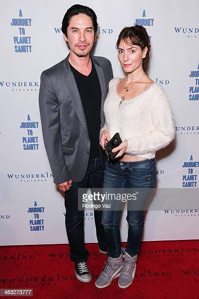 Actors Michael Teh and Jennifer Capriccio attend 'A Journey To Planet Sanity' Los Angeles Premiere at Laemmle Monica 4Plex on December 2 2013 in...