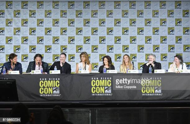 Actors Michael Trucco Aaron Douglas Tahmoh Penikett Grace Park Mary McDonnell and Tricia Helfer writers David Eick and Ron Moore speak onstage at...