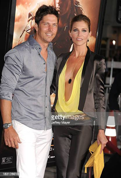 Actors Michael Trucco and Tricia Helfer arrive at the Los Angeles premiere of 'Riddick' at the Westwood Village Theatre on August 28 2013 in Westwood...
