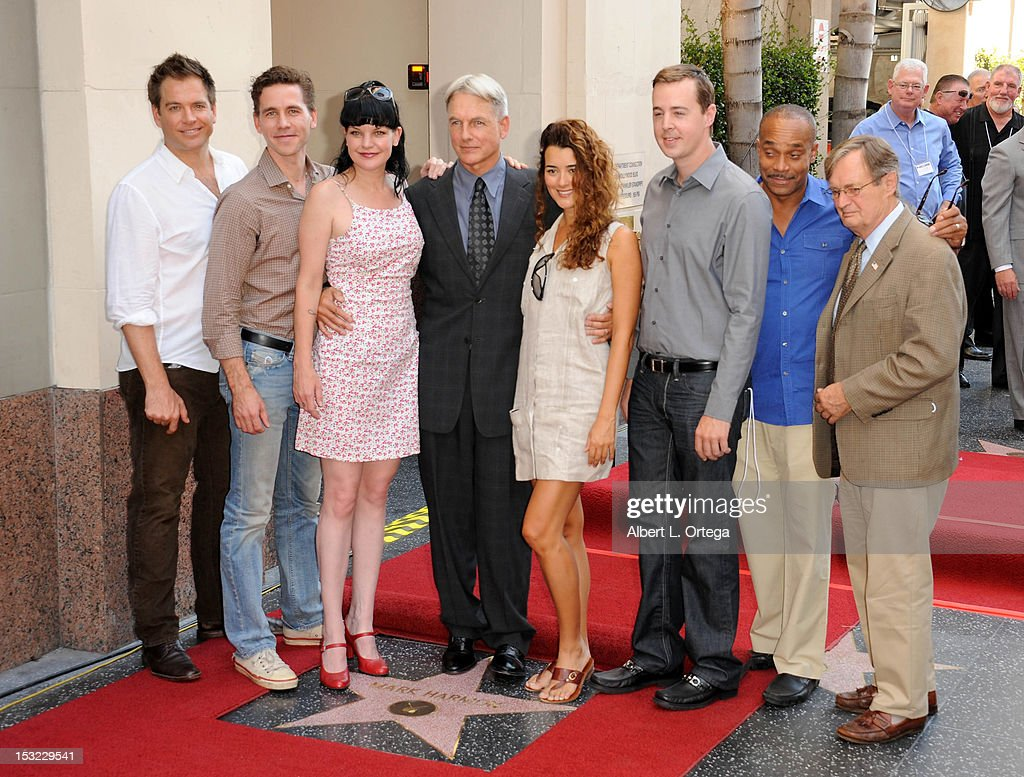 Actors Michael Weatherly, Brian Dietzen, Pauley Perrette, Mark Harmon, Cote de Pablo, Sean Murray, Rocky Caroll and David McCallum participate in the Mark Harmon Star Ceremony on The Hollywood Walk Of Fame on October 1, 2012 in Hollywood, California.