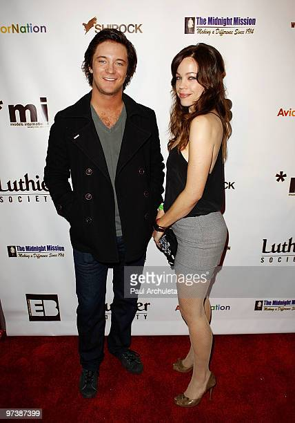 Actors Michael Welch Joanna Garcia arrive at the Everything Burns In Hollywood Red Carpet Charity Drive at The Roxy Theatre on March 2 2010 in West...
